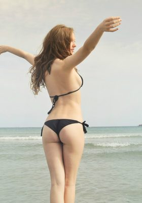 woman-in-black-bikini-standing-on-shore-825904